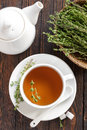 Thyme tea in a cup and fresh herbs Stock Image