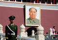 Tiananmen square chairman mao zedong s portrait with chinese soldeiron guard in foreground Royalty Free Stock Photo