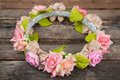 Tiara of artificial roses on wooden background wood Stock Images