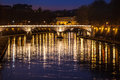 Tiber River, bridge and reflections on water. Night Rome, Italy. Royalty Free Stock Photo