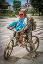 Tibetan boy little sitting on a sculpture of a cyclist in shigatse tibet Stock Photography