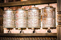 Tibetan buddhism prayer wheels close up Royalty Free Stock Image