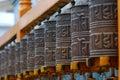 Tibetan Buddhist Prayer Wheels In A Row Stock Photos