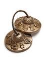 Tibetan buddhist tingsha cymbals isolated on white Stock Photos