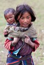 Tibetan girl with baby Stock Photo