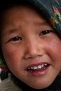 Tibetan girl a posing to the camera in the a remote himalayan village in pin valley taken at mudh pin valley himachal pradesh Royalty Free Stock Images