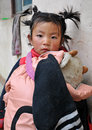 Tibetan girl young playing outdoors Stock Images
