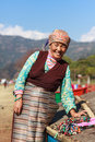 Tibetan lady selling Royalty Free Stock Photo
