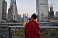 Tibetan Monk Filming Shanghai city Stock Photo
