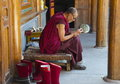 Tibetan monk relaxing in ta er monastery Royalty Free Stock Image