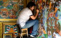 Tibetan painter a man creating religious paintings near the llama temple in beijing Royalty Free Stock Image