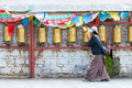 Tibetan pilgrim circles the Potala palace Stock Photo