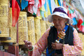 Tibetan pilgrim circles the Potala palace Royalty Free Stock Image