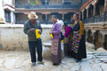 Tibetan pilgrims make offerings Royalty Free Stock Images