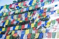 Tibetan prayer flags or colorful Buddhist prayer flags hanging in Kathmandu, Nepal to send prayers messages in the wind for pe Royalty Free Stock Photo