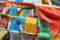 Tibetan prayer flags colourful blowing in the wind Stock Photo