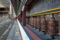 Tibetan prayer wheels or prayers rolls of the faithful Buddhists. Horizontal photo. Royalty Free Stock Photo