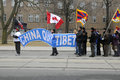 Tibetan protest toronto march canadian tibetans with a huge banner asking china to quit tibet marching in a rally organized to Stock Image