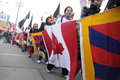 Tibetan protest toronto march tibetans with the flags of canada and tibet together marching in a rally organized to against the Royalty Free Stock Photography