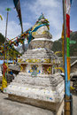 Tibetan Stupa with Prayer Flags in Jiuzhaigou, China Royalty Free Stock Photo
