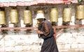 Tibetan turns pray wheel Stock Images