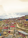 Tibetan village in the mountain landscape of China Royalty Free Stock Photo