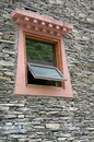 Tibetan window close up picture of on stone wall Royalty Free Stock Photos