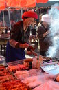 Tibetan woman cooking on the streets of old town of shangrila yunnan china Royalty Free Stock Photo