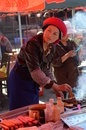 Tibetan woman cooking on the streets of old town of shangrila yunnan china Stock Images