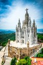 Tibidabo church on mountain in barcelona with christ statue overviewing the city Stock Photos