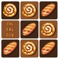 Tic-Tac-Toe of bread and cinnamon roll Royalty Free Stock Photo