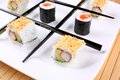 Tic tac toe play with sushi and chopsticks close up Royalty Free Stock Images
