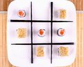 Tic tac toe sushi chopsticks top view Royalty Free Stock Images