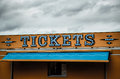 Tickets lighted sign at a fairground made of individual blue bulbs lightning Royalty Free Stock Image