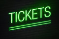 Tickets neon sign on wall green with text Royalty Free Stock Photos