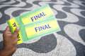 Tickets to football soccer final in copacabana rio brazil hand holds pair of world cup event de janeiro Royalty Free Stock Image