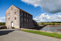 Tidal mill at carew pembrokeshire wales is a popular tourist destination Stock Photo