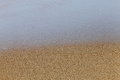 Tide withdraw from sea shore or wave retreat beach exposing the sand texture Stock Photography
