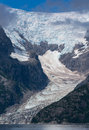 Tidewater and hanging glacier part of this reaches the sea while another hangs off a steep mountain side Royalty Free Stock Images