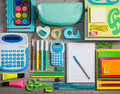 Tidy student colorful stationery perfectly on wooden surface flooring Stock Photos
