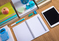 Tidy student desktop stationery and equipment perfectly on wooden surface Royalty Free Stock Images