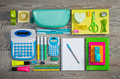 Tidy student stationery and equipment perfectly on wooden surface Royalty Free Stock Images