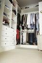 Tidy teenage bedroom with neat wardrobe Royalty Free Stock Photo