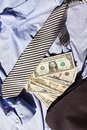 Tie and dollars lying on dolarach lying on a blue striped shirt Royalty Free Stock Photo