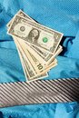 Tie and dollars lying on dolarach lying on a blue striped shirt Stock Photo