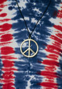 Tie Dye Shirt with Peace Symbol Necklace Stock Images