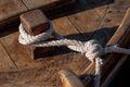 Tied boat rope to dock Royalty Free Stock Photo
