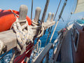 Tied off rope on a  wooden sailing boat Royalty Free Stock Photo