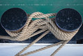 Tied rope on ship in harbor Royalty Free Stock Photo