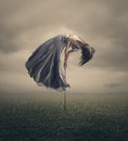Tied to the earth a woman is being pulled towards sky but Royalty Free Stock Images